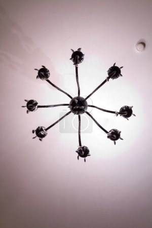 Simple chandelier bottom view with white ceiling background