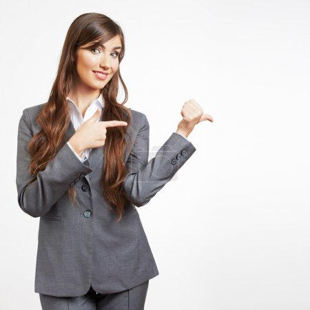 Portrait of smiling business woman show finger, is...
