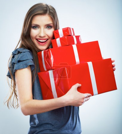 Photo for Portrait of casual young happy smiling woman hold red gift box. Isolated studio background female model. - Royalty Free Image