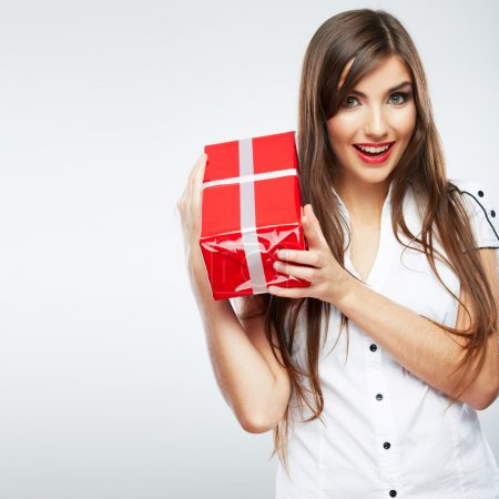 Photo for Young beautiful woman holding red gift box - Royalty Free Image