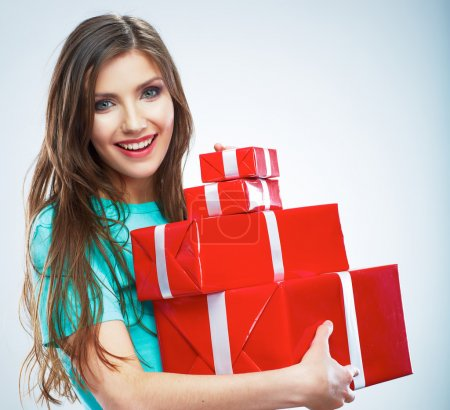 Photo for Portrait of young happy smiling woman hold red gift box. Isolated studio background female model. - Royalty Free Image