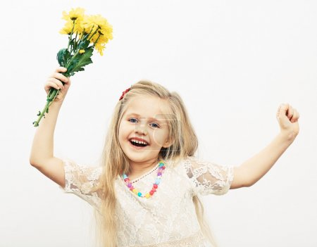 Photo for Smiling girl hold yellow flowers. Fashion child portrait. - Royalty Free Image