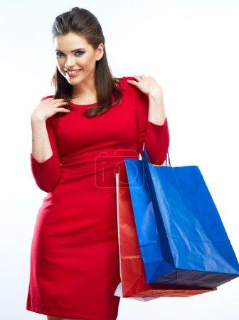Photo pour Femme tenir des sacs à provisions isolés sur fond blanc. Jeune modèle féminin - image libre de droit