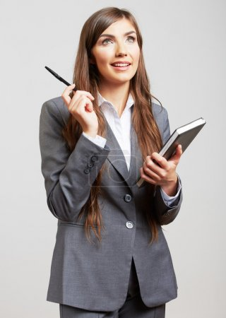 Photo for Isolated portrait of young business woman with book and pen - Royalty Free Image