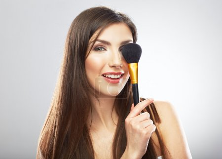 Woman hold make up brush