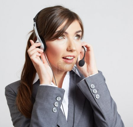 Foto de Cerrar el retrato de la mujer trabajadora de servicio al cliente, teleoperador centro sonriente con auricular de teléfono - Imagen libre de derechos