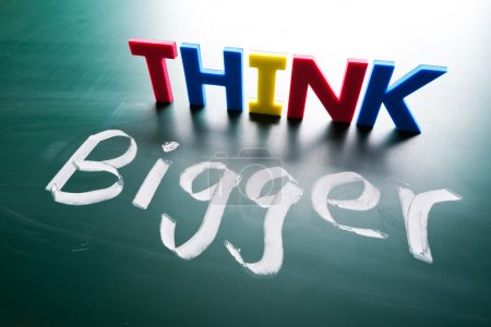 Photo for Think bigger concept, words on blackboard - Royalty Free Image