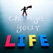 Change your life concept, man and words on blackboard