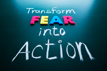 Photo for Transform fear into action concept, colorful words on blackboard - Royalty Free Image