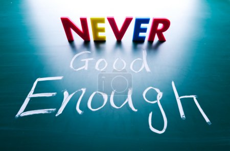 Photo for Never good enough concept, words on blackboard - Royalty Free Image