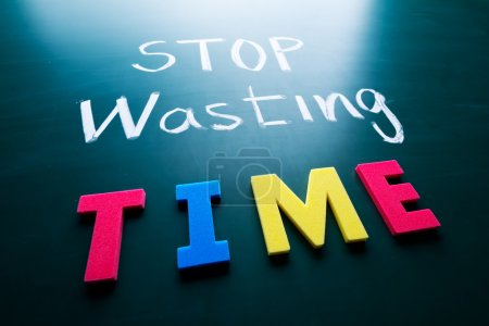 Photo for Stop wasting time concept, colorful words on blackboard - Royalty Free Image