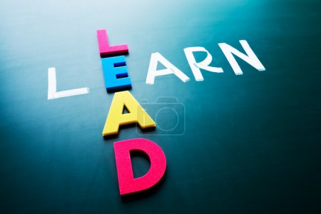 Photo for Lead and learn, conceptual words on blackboard - Royalty Free Image