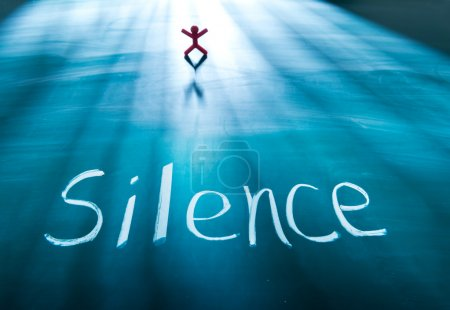 Silence concept, conceptual word on blackboard