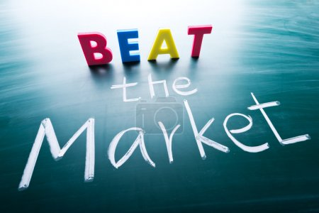 Photo for Beat the market, conceptual words on blackboard - Royalty Free Image