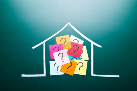 Photo for Color question mark in drawing house on blackboard - Royalty Free Image