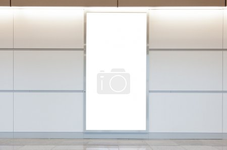 Photo for Vertical blank billboard on a bright wall - Royalty Free Image