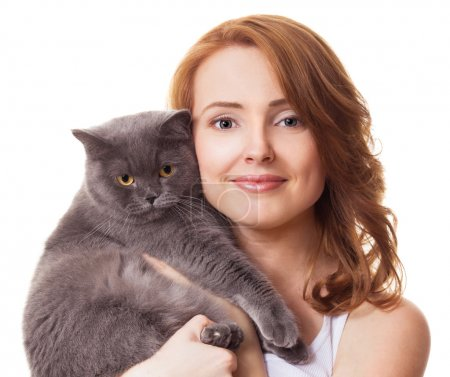 Photo pour Beautiful young woman holding a cat, isolated against white background - image libre de droit