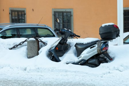 Scooter Buried with Snow
