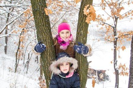 Two little girls having fun in winter