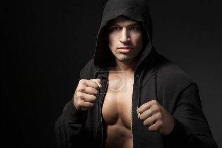 Photo for Strong man fighter portrait isolated on black background - Royalty Free Image