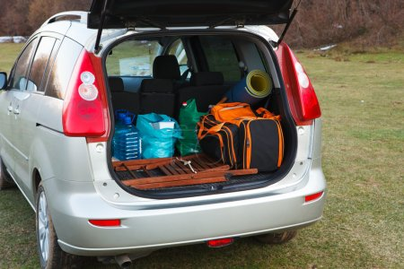 hatchback car loaded with open trunk and luggage