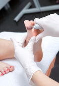 Peeling feet pedicure procedure in a beauty salon