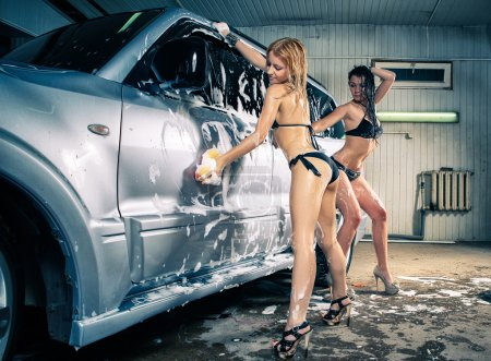 Models at the car wash in garage. Cross processing...
