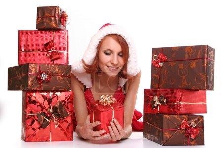 Photo pour Sexy jeune Santa-girl avec des cadeaux - image libre de droit