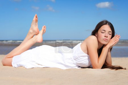Photo for Beautiful young woman relaxing on sea - Royalty Free Image