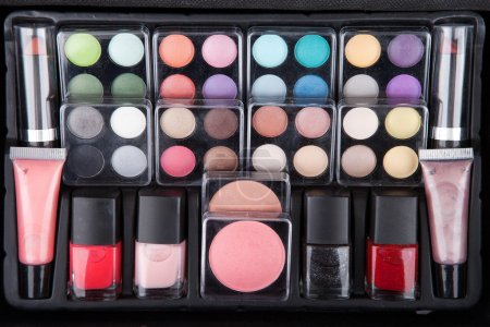 Make up case containing colorful eyeshadows, lipst...
