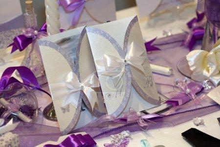Handmade wedding invitation made of silver paper
