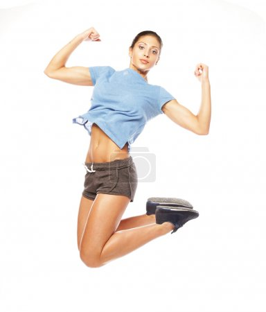 Fitness woman jumping of joy.