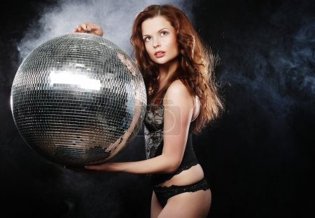 Photo for Dancer girl in smoke with disco ball - Royalty Free Image