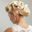 Beautiful bride with fashion wedding hairstyle - o...