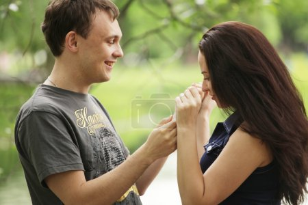 Happy young guy with girlfriend