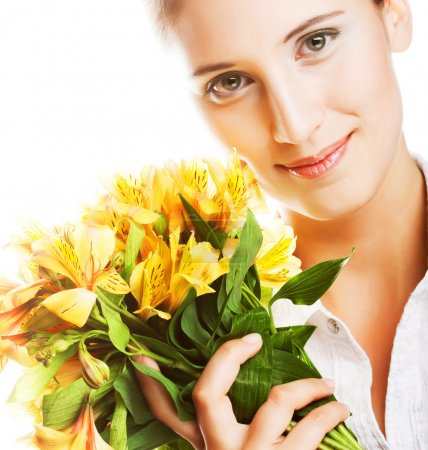 Photo for Beautiful young woman with yellow flowers - Royalty Free Image