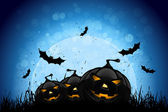 Halloween Party Background with Pumpkins in the Grass Bats and Moon in the Back