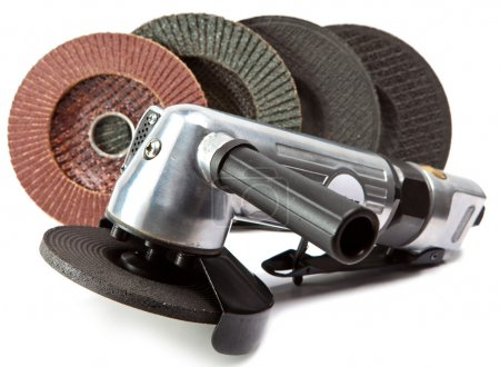 Air angle grinder and different grinding wheels on white background
