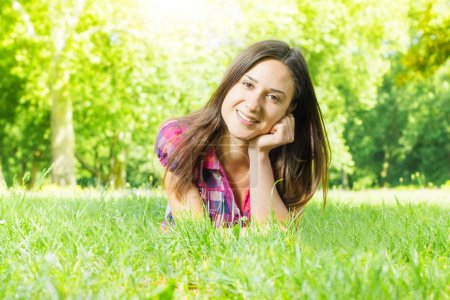 Beautiful smiling young woman relaxing