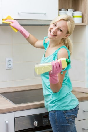 Photo for Happy housewife cleaning in the kitchen. - Royalty Free Image