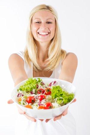 glückliche junge Frau mit gesundem Essen
