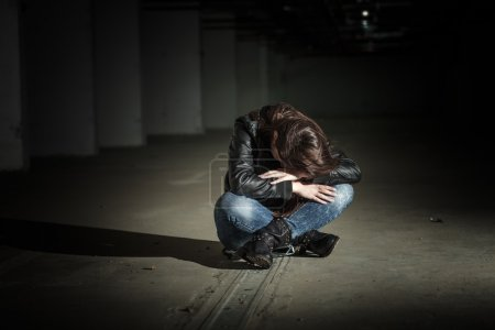 Photo for Depressed teenage girl with hands over face. - Royalty Free Image