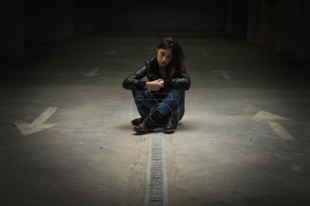 Photo for Depressed and lonely teenage girl sitting on the floor. - Royalty Free Image