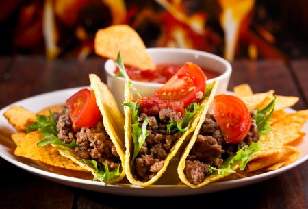 Photo for Plate with taco, nachos chips and tomato dip - Royalty Free Image
