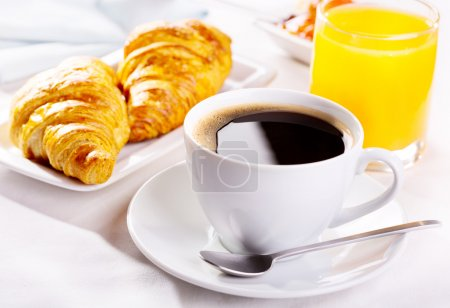 Photo for Breakfast with cup of coffee, croissants and orange juice - Royalty Free Image
