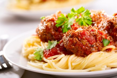 Photo for Pasta with meatballs and parsley with tomato sauce - Royalty Free Image