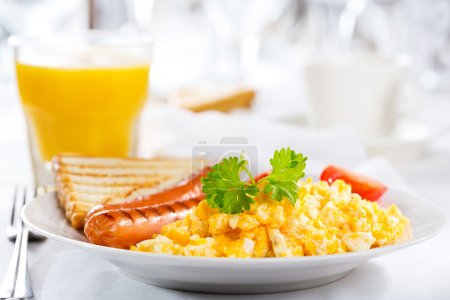 Photo for Breakfast with scrambled eggs and sausages - Royalty Free Image