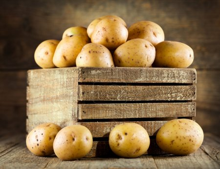 Photo for Fresh potatoes in wooden box - Royalty Free Image