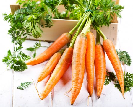 Photo for Fresh carrots on wooden table - Royalty Free Image