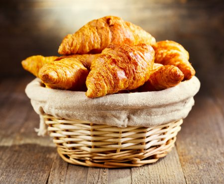 Photo for Fresh croissants on wooden table - Royalty Free Image